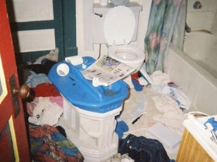 The toilet floor is covered in clothes. Picture: Brynlee Hollis / Imgur