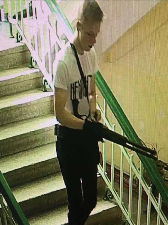 Student Vladislav Roslyakov, 18, stalking the halls of the Crimean school. Picture: CCTV