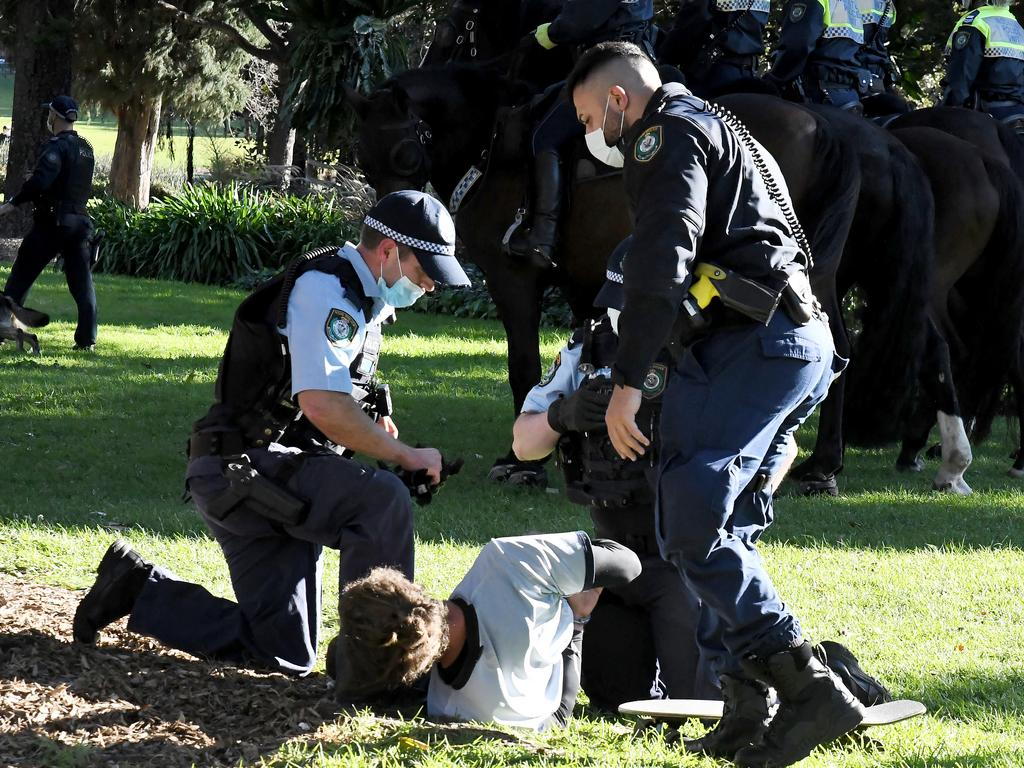 Police arrest a man at Saturday's Sydney protest.