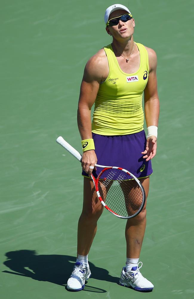 Samantha Stosur reacts after a missed point during her match against Serena Williams.