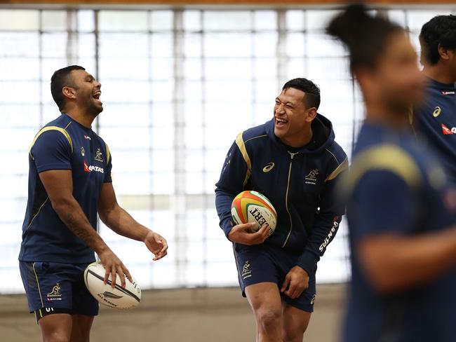Kurtley Beale (L) and Israel Folau share a laugh during the Wallabies' indoor training session.
