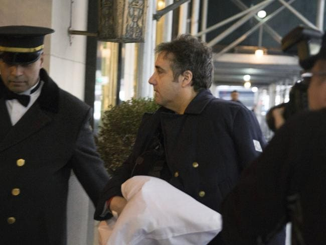 Democrats are calling for an investigation into the allegations Mr Trump ordered lawyer Michael Cohen, pictured arriving at his New York home on Thursday, to cover up information relating to a possible Moscow real estate deal. Picture: AP Photo/Kevin Hagen