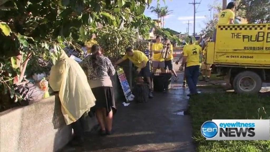 Bobolas family look on as police attempt to clean-up front yard