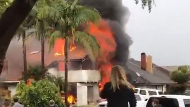 Plane crashes in Yorba Linda, California, houses burn
