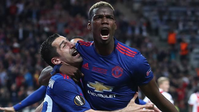 Henrikh Mkhitaryan (L) with Paul Pogba of Manchester United.