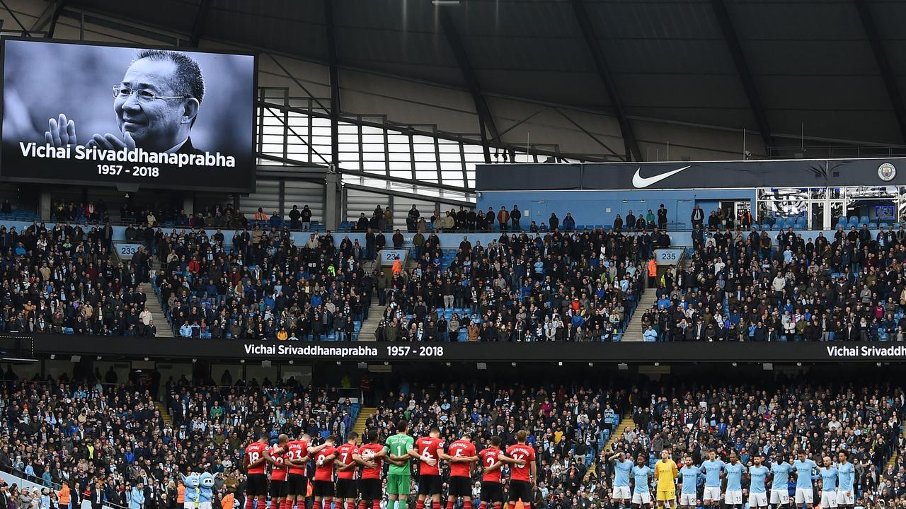 Players from both sides line up to observe a minute's silence before Man City v Southampton