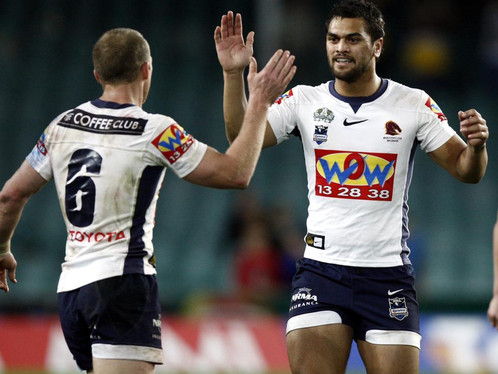 Darren Lockyer (6) and Karmichael Hunt celebrate at full time following Sydney Roosters v Brisbane Broncos NRL qualifying final at SFS in Sydney.