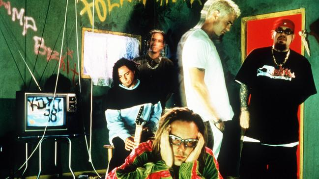 Welch, second from left, in a press shot for Korn.