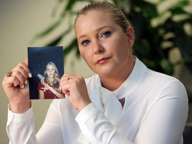 Virginia Roberts holds a photo of herself at age 16. Picture: Emily Michot/Miami Herald/Tribune News Service/Getty Images