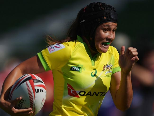 Page McGregor of Australia scoring a try at the Dubai rugby sevens event.