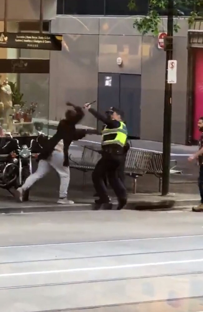 The Bourke Street attacker attempts to stop police from intervening.