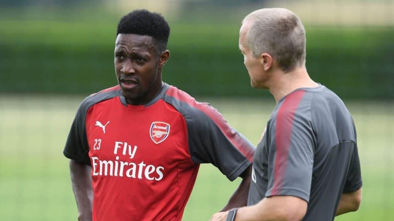 Darren Burgess with Arsenal's Danny Welbeck.