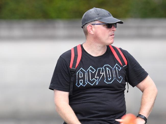 An AC/DC fan shows his colours outside the funeral. Picture: AAP Image/Dean Lewins