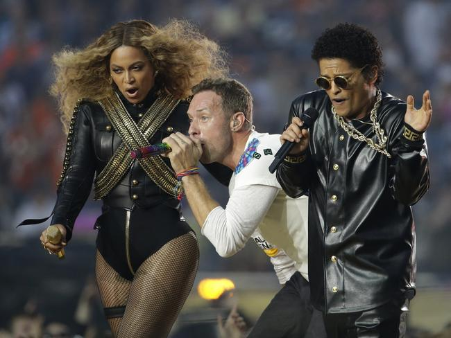 Big show ... Beyonce, Coldplay singer Chris Martin and Bruno Mars perform during halftime of the NFL Super Bowl 50. Picture: AP Photo/Julio Cortez