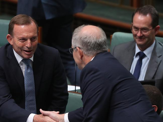 Scott Morrison shakes hands with former PM Tony Abbott. Picture: Kym Smith