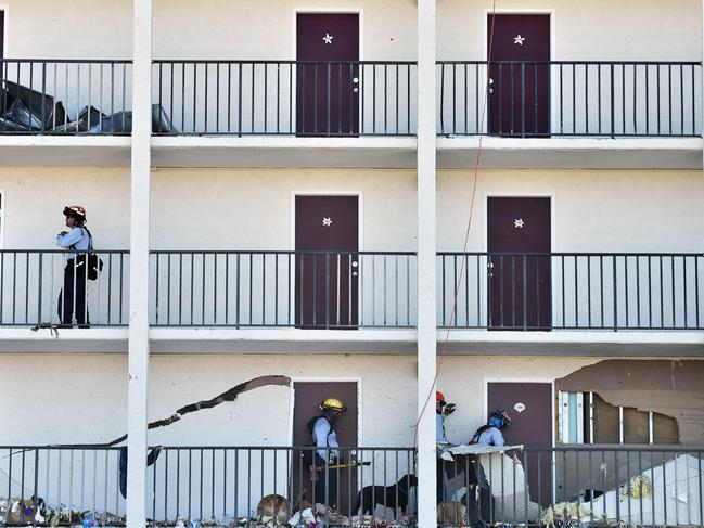 Members of City Miami Fire Rescue look for victims in a building in Mexico Beach. Picture: Hector Retamal/AFP