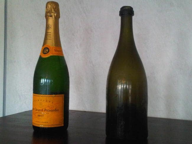 One of the salvaged bottles next to a modern bottle of Veuve Clicquot. Picture: AP Photo/Lehtikuva/Jussi Nukari