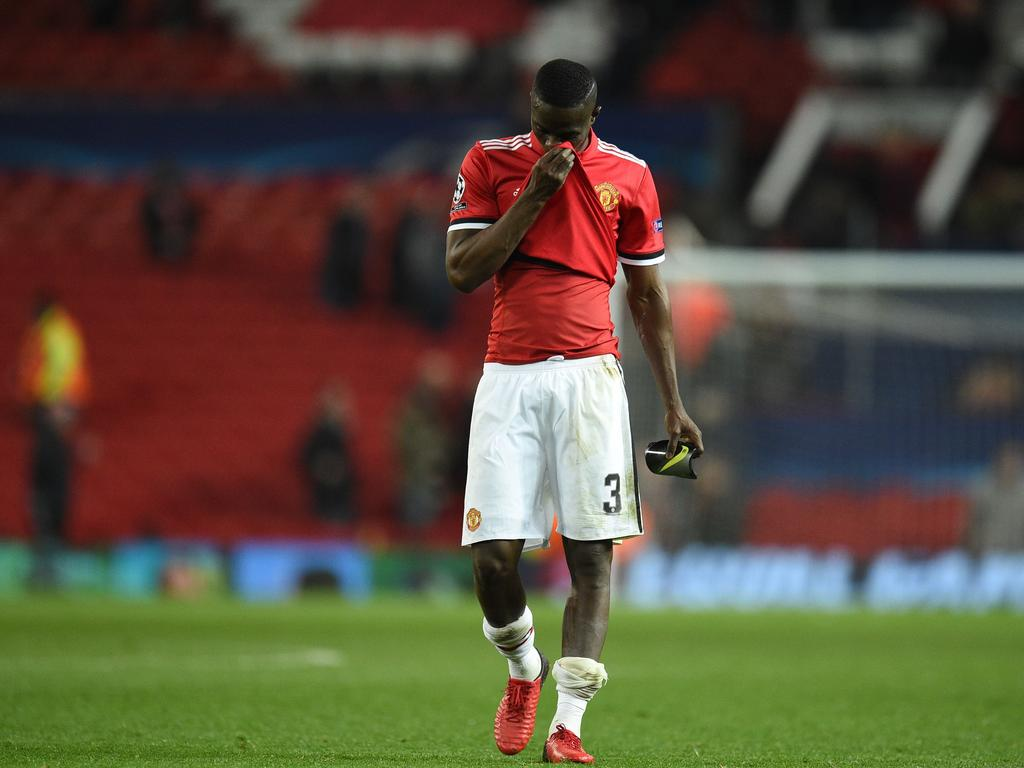 Manchester United's Ivorian defender Eric Bailly leaves the pitch after losing a last 16 second leg UEFA Champions League football match between Manchester United and Sevilla at Old Trafford in Manchester, northwest England on March 13, 2018. / AFP PHOTO / Oli SCARFF