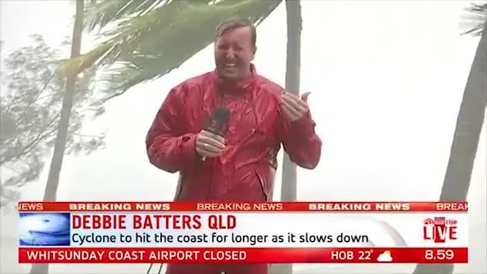 Reporters battered by Cyclone Debbie