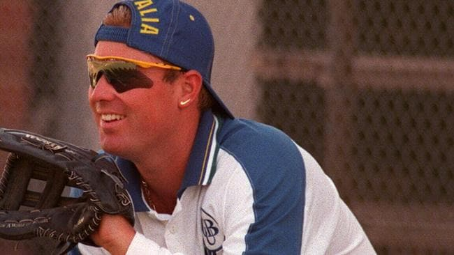 Aust cricketer Shane Warne wearing baseball glove during cricket practice at Adelaide Oval.