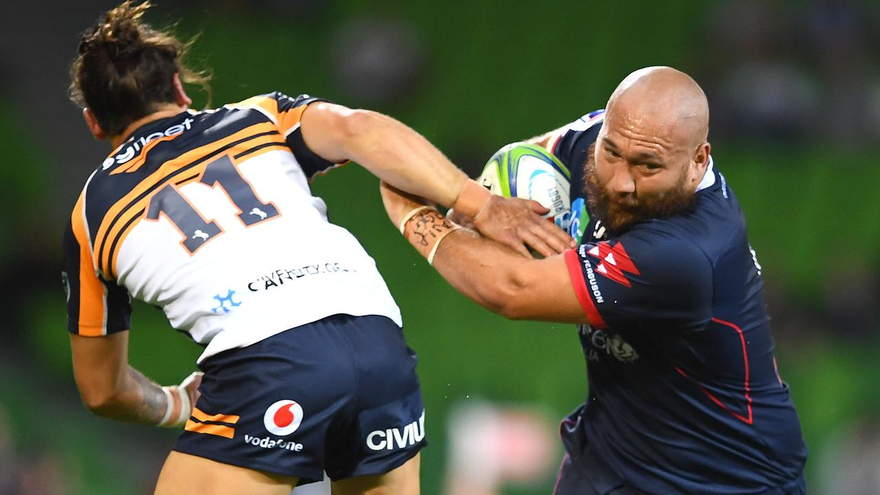 Robbie Abel of the Rebels is tackled by Andy Muirhead of the Brumbies at AAMI Park.