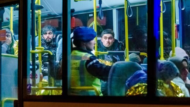 The migrants were taken from the ferry by bus for police processing. Picture: Marco De Swart/ANP/AFP/Netherlands