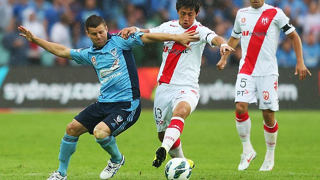 Sydney's Jason Culina competes for the ball with Heart's Jonathan Germano. Picture: Brendon Thorne