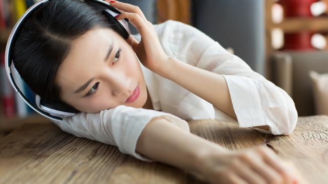 girl lying on the table, quietly listening to music