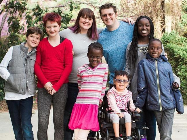"""The Dingle Family; four of the children were adopted and each child was """"uniquely supported"""" by their late father, Lee Dingle. Picture: Supplied"""