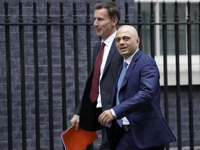 Britain's Foreign Secretary Jeremy Hunt and Secretary of State for the Home Department Sajid Javid, right, arrive to attend a cabinet meeting at Downing Street in London. Picture: AP