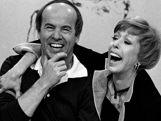 Carol Burnett, right, laughs with Tim Conway during taping of her final show, in Los Angeles. Picture: AP