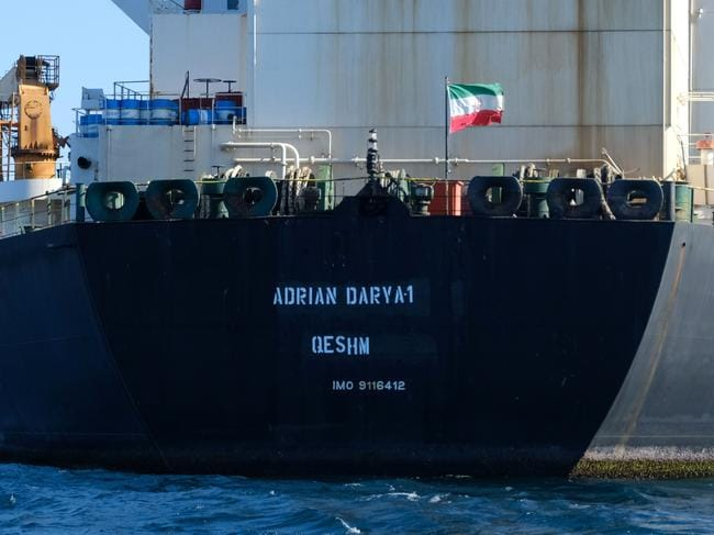 (FILES) In this file photo taken on August 18, 2019 an Iranian flag flutters on board the Adrian Darya oil tanker, formerly known as Grace 1, off the coast of Gibraltar. — An Iranian tanker released after being detained for six weeks by the British overseas territory of Gibraltar is now headed for Lebanon, Turkey's Foreign Minister Mevlut Cavusoglu said on August 30, 2019. (Photo by Johnny BUGEJA / AFP)