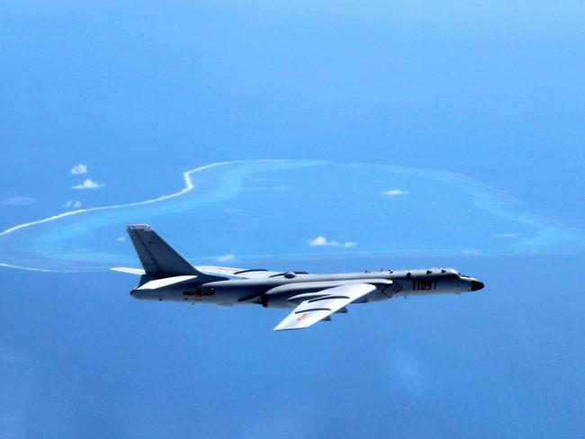 A Chinese H-6K bomber patrols the islands and reefs in the South China Sea. Picture: Xinhua