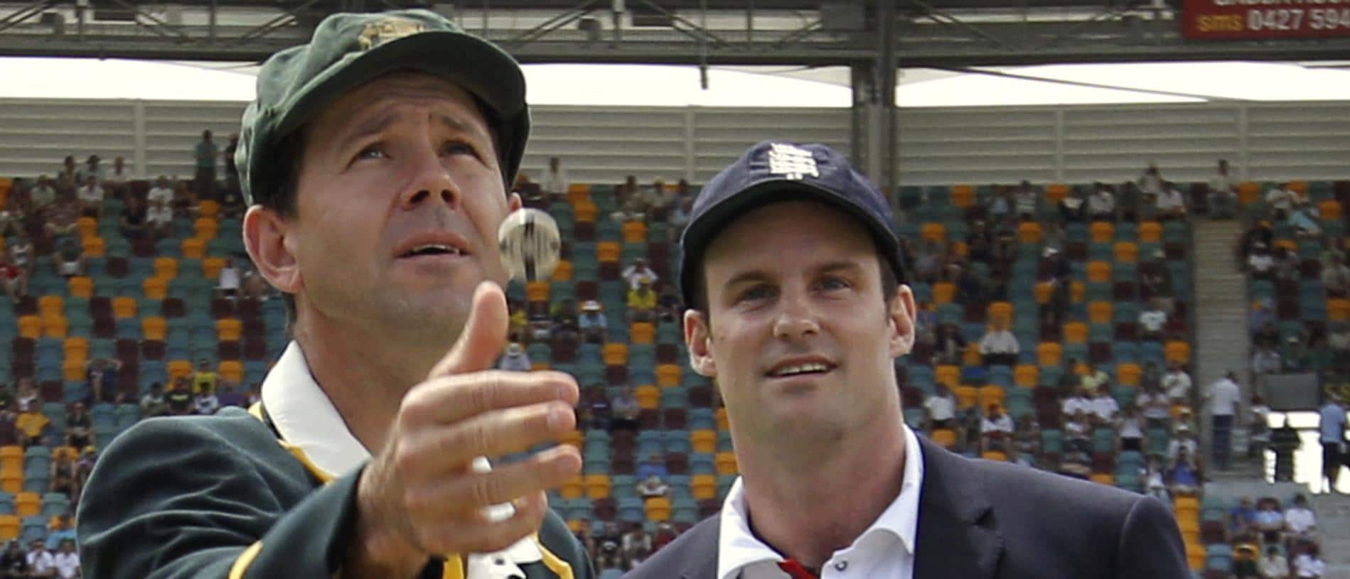 Australia's captain Ricky Ponting, left, tosses the coin as England's captain Andrew Strauss watches at the start of the first day of the first Ashes cricket test in Brisbane, Australia, Thursday, Nov. 25, 2010. Engalnd won the toss and chose to bat. (AP Photo/Hamish Blair, Pool)