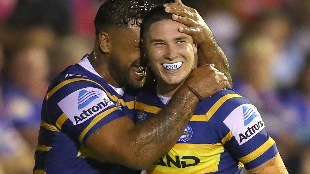 Mitchell Moses celebrates a try for the Eels.