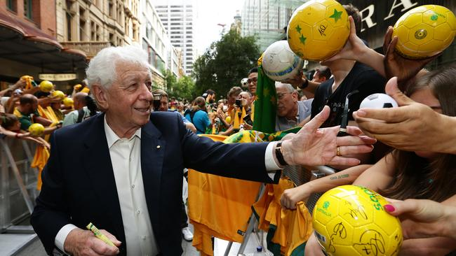 Frank Lowy celebrates with fans in Sydney after the Socceroos' Asian Cup triumph.