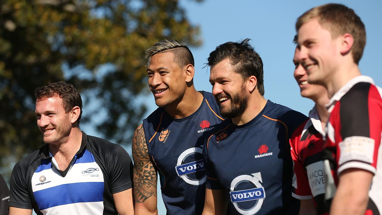 Israel Folau and Adam Ashley-Cooper pose with players from the Sydney Convicts during a Waratahs training session at Kippax Lake on July 3, 2014 in Sydney.