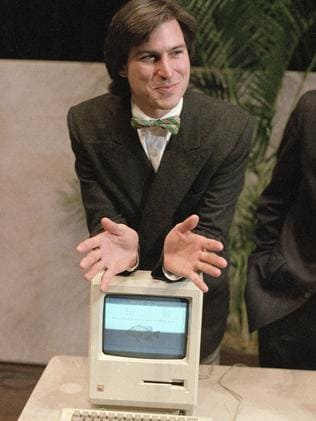 Steve Jobs leans on the new Macintosh personal computer in 1984. Picture: AP