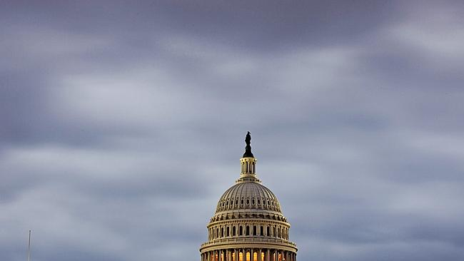 Stormclouds over Washington as the shutdown enters its second week. Picture: AP Photo, J. Scott Applewhite.