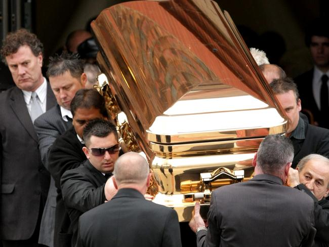 Dhakota's father, underbelly crime czar Carl Williams, is buried gangster style in a gold coffin in 2010, when his daughter was nine. Picture: Stuart McEvoy
