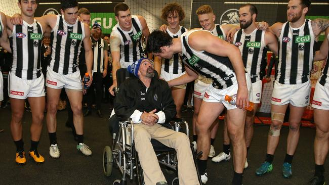 Murray Swinton with Collingwood players after Queen's Birthday. Picture: Michael Klein
