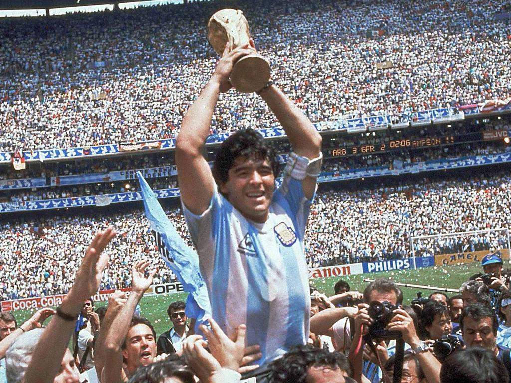 ** FILE ** In this June 29, 1986 file photo Diego Maradona of Argentina celebrates with the cup at the end of the World Cup soccer final in the Atzeca Stadium, in Mexico City, Mexico. A star who was addicted to drugs, sentenced to jail for shooting at reporters and punched the ball into the net in a World Cup quarterfinal doesn't seem like the ideal candidate to coach a national football team. But this is Diego Maradona, one of football's all-time greats who can do no wrong in the eyes of Argentina's fans. Maradona, who turns 48 on Thursday, and Carlos Bilardo have been asked to lead the national team by Julio Grondona, head of the Argentine Football Association. (AP Photo/Carlo Fumagalli, File)