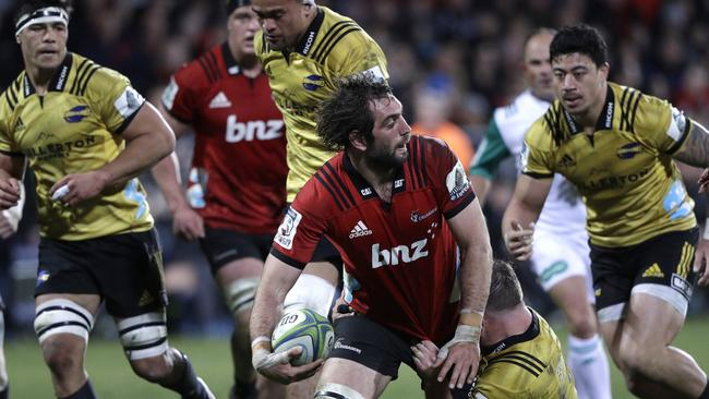 Crusaders captain Sam Whitelock looks for support as he runs at the Hurricanes defence.
