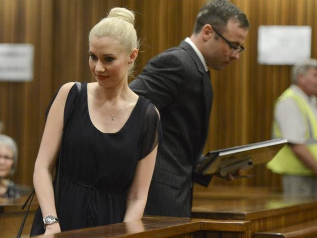 Oscar Pistorius makes his way past his ex girlfriend Samantha Taylor as he arrives in the Pretoria High Court for sentencing in his murder trial. Picture: Getty