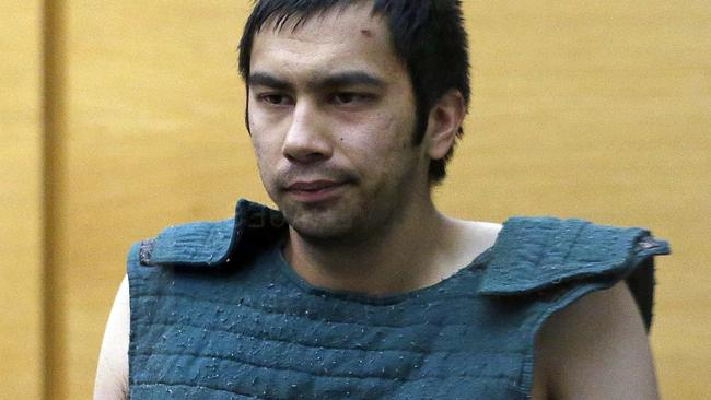 Shooting suspect Aaron Ybarra is led to a court hearing at a King County Jail courtroom in Seattle. Picture: Elaine Thompson