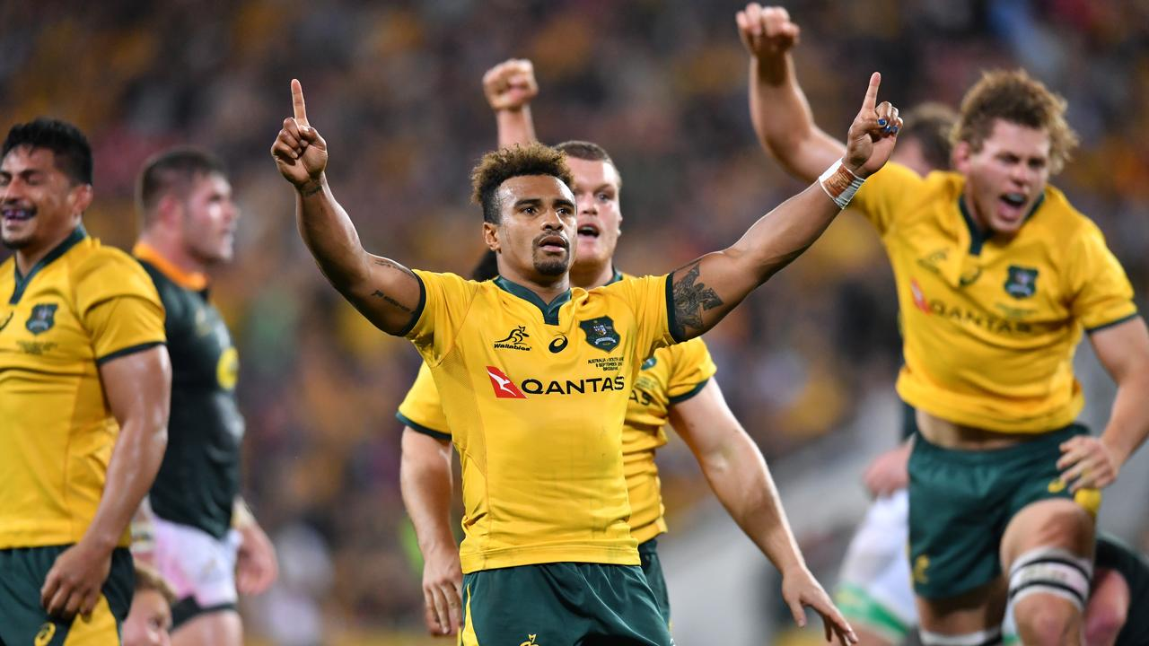 Will Genia (centre) celebrates after the Wallabies held on to beat the Springboks in Brisbane.