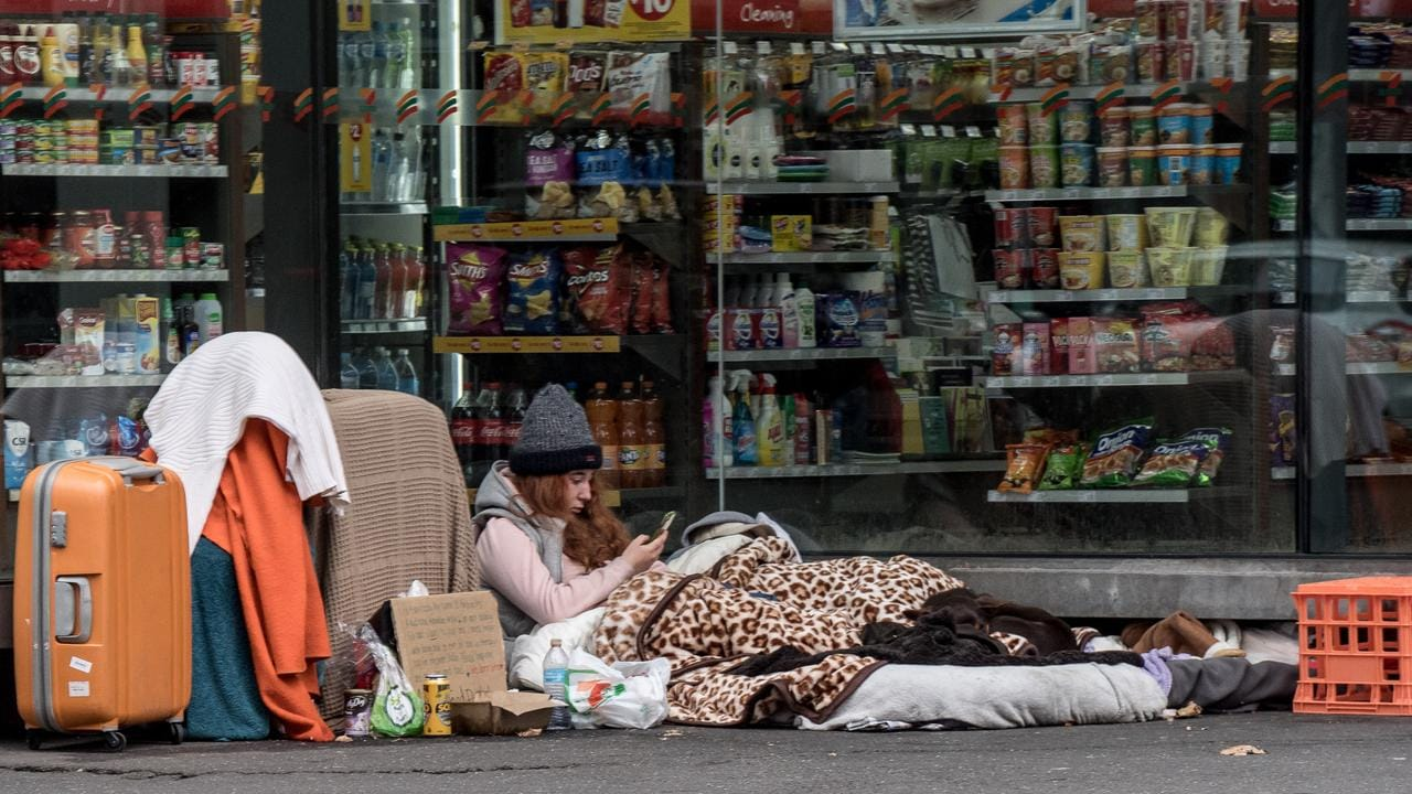 Homeless people camping on the street in Melbourne.