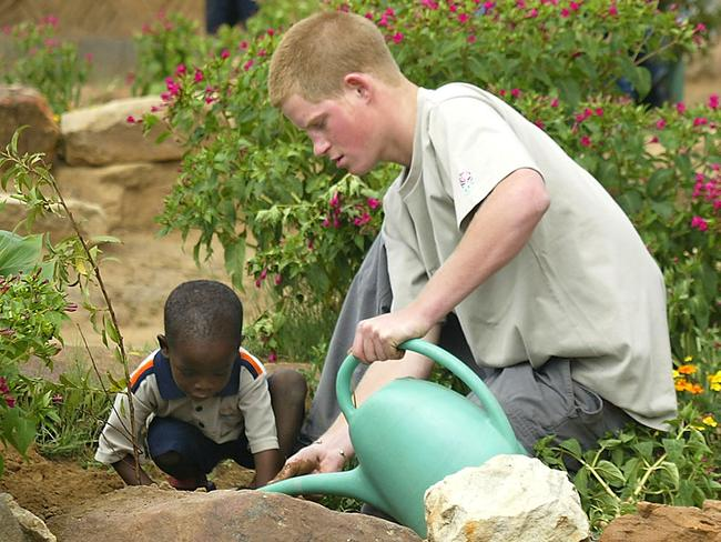 Nineteen-year-old Prince Harry and Mutsu Potsane, 4, plant a fruit tree at the Mants'ase Children's Home near Mohale's Hoek, Lesotho. Picture: AP
