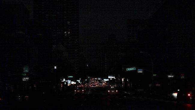 Cars drive down a darkened 2nd Avenue after Hurricane Sandy. Picture: AFP