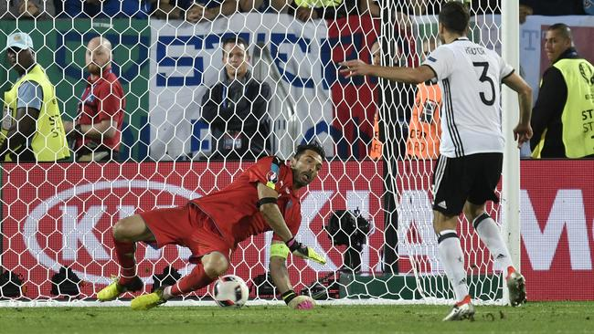 Germany's Jonas Hector scores the winning penalty.